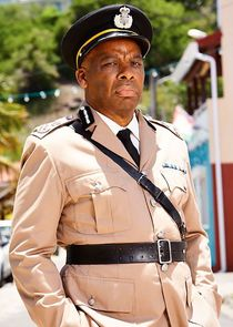 In Death in Paradise as Commissioner Selwyn Patterson